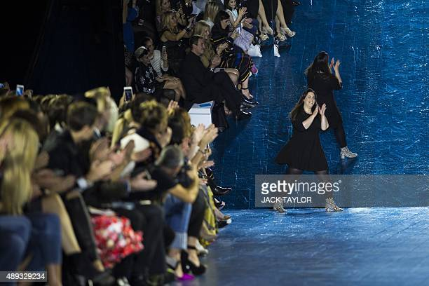 Greek fashion designer Mary Katrantzou greets the audience after presenting her Spring / Summer 2016 collection during London Fashion Week in London...