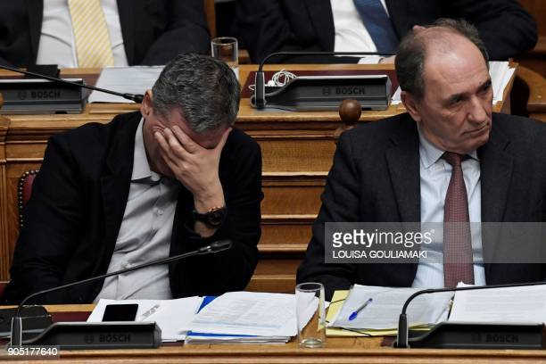 Greek Finance Minister Euclid Tsakalotos and Economy Minister Giorgos Stathakis listen to Greek Prime Minister delivering a speech at the Greek...
