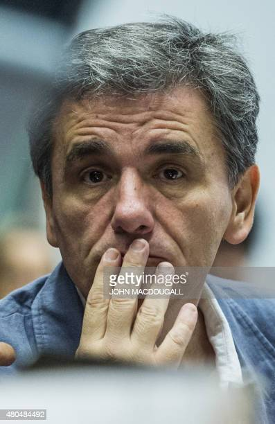 Greek Finance Minister Euclid Tsakalotos attends a meeting of the Eurogroup finance ministers in Brussels on July 12 2015 The EU cancelled a full...