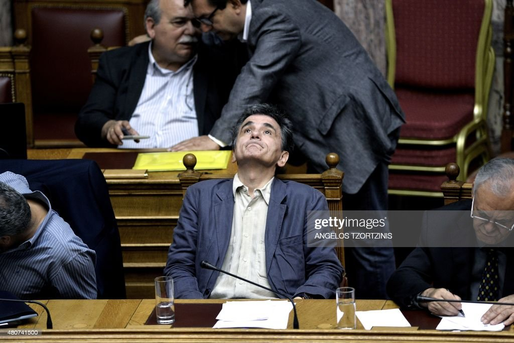 Greek Finance Minister Euclid Tsakalotos attends a parliament session in Athens, on July 15, 2015. Greece geared up for a parliamentary vote on draconian reforms demanded by eurozone creditors in exchange for a huge new bailout, just hours after a bombshell report from the International Monetary Fund criticised the deal.