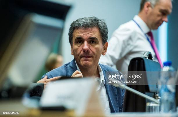 Greek Finance Minister Euclid Tsakalotos gestures as he attends a meeting of the Eurogroup finance ministers in Brussels on July 12 2015 The EU...