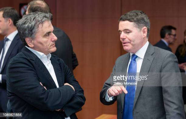 Greek Finance Minister Euclid Tsakalotos is talking with the Irish Minister for Public Expenditure and Reform Paschal Luke Donohoe prior to an...