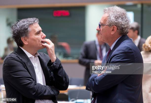 BRUSSELS BELGIUM JULY 13 Greek Finance Minister Euclid Tsakalotos is talking with the Luxembourg Minister of Finance Treasury Budget Pierre Gramegna...