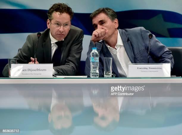 Greek Finance Minister Euclid Tsakalotos listens speaks to the Chair of the Eurogroup finance ministers Jeroen Dijsselbloem during their joint press...