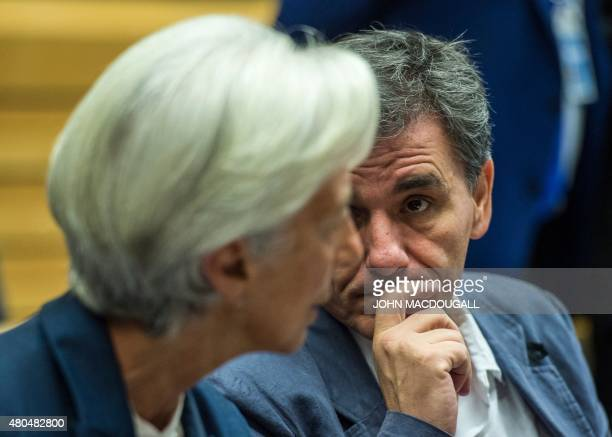 Greek Finance Minister Euclid Tsakalotos speaks with Managing Director of the International Monetary Fund Christine Lagarde during a meeting of the...
