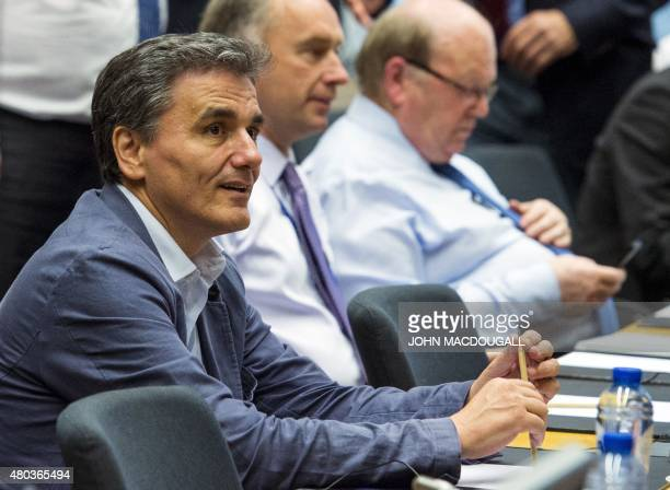 Greek Finance Minister Euclid Tsakalotos takes part in a meeting of the Eurogroup finance ministers in Brussels on July 11 2015 German Finance...