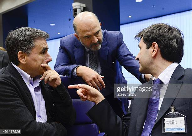 Greek Finance Minister Euclid Tsakalotos talks with EU Commissioner of Economic and Financial Affairs Taxation and Customs Pierre Moscovici and...