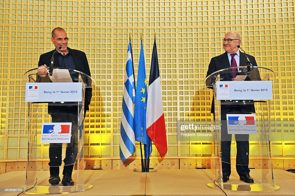 Greek Finance Minister Yanis Varoufakis (L) and his French counterpart Michel Sapin (R) speak during at a press conference following their meeting at the French Finance Ministry on February 1, 2015 in Paris, France. Yanis Varoufakis is on a two-days visit to Paris to launch the Greek new anti-austerity government's search for EU allies.