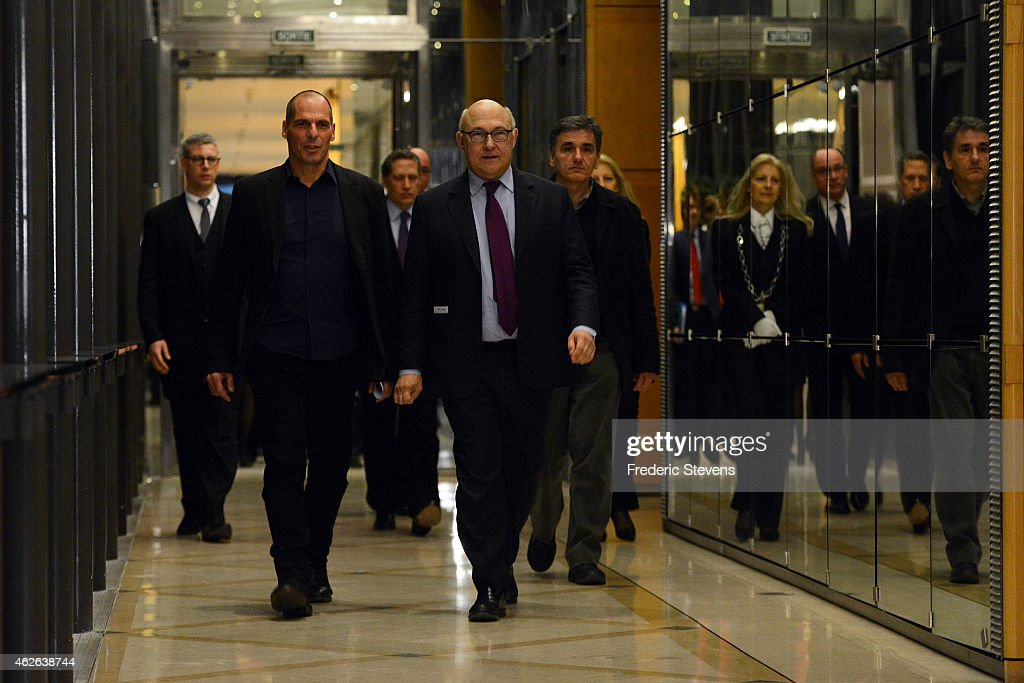 Greek Finance Minister Yanis Varoufakis (L) and his French counterpart Michel Sapin arrive at a press conference following their meeting at the French Finance Ministry on February 1, 2015 in Paris, France. Yanis Varoufakis is on a two-days visit to Paris to launch the Greek new anti-austerity government's search for EU allies.