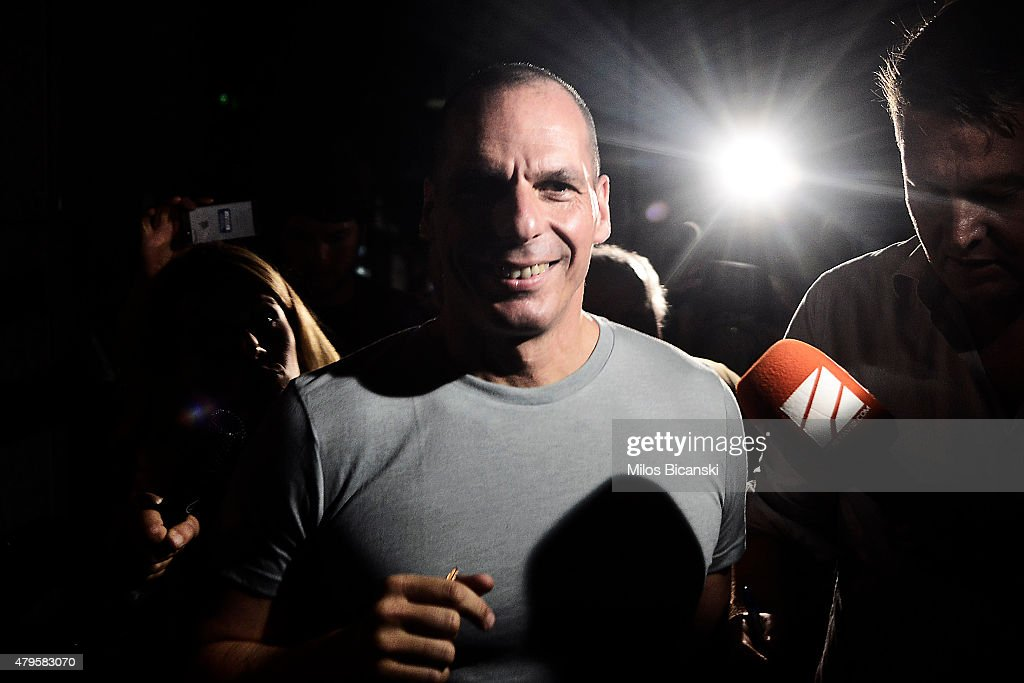 Greek Finance Minister Yanis Varoufakis leaves his office as Greek voters are expected to vote no in the Greek austerity referendum, on July 5, 2015 in Athens, Greece. The people of Greece are going to the polls to decide if the country should accept the terms and conditions of a bailout with its creditors. Greek Prime Minister Alexis Tsipras is urging people to vote 'a proud no' to European creditors' proposals, and 'live with dignity in Europe'. 'Yes' campaigners believe that a no vote would mean financial ruin for Greece and the loss of the Euro currency.