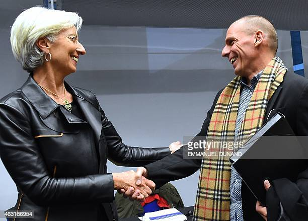 Greek Finance Minister Yanis Varoufakis shakes hands with International Monetary Fund Director Christine Lagarde during an emergency Eurogroup...
