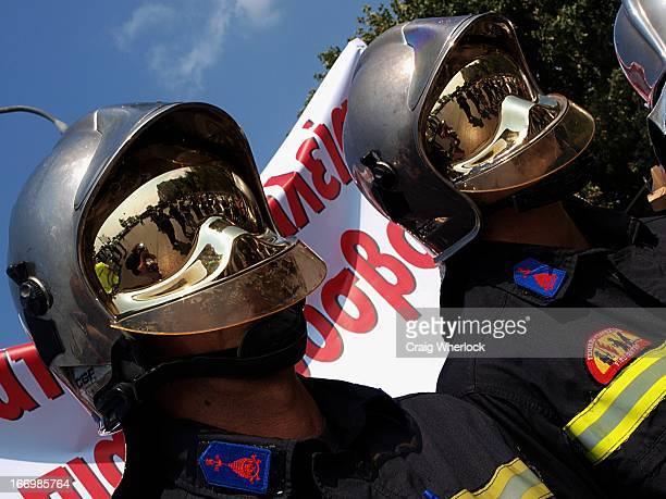 CONTENT] Greek firemen in antiflame helmets protesting cuts in salaries