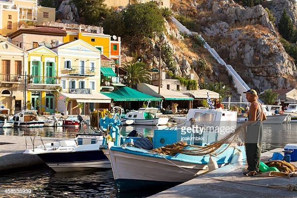 greek fisherman - symi stock photos and pictures