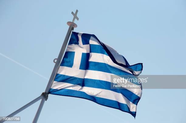 greek flag at kavala, eastern macedonia region, greece - macedonië land stockfoto's en -beelden