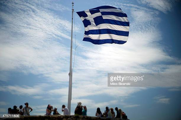 Greek flag billows in the wind on the Acropolis Hill on June 3 in Athens Greece Greek Prime Minister Alexis Tsipras is expected to be presented with...