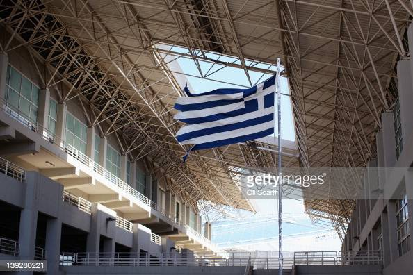 A Greek Flag Flies On Walkway Between The Olympic Indoor Pool And