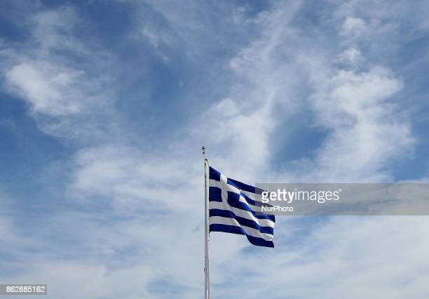 A Greek flag flutters atop the Acropolis hill in Athens Greece Wednesday October 18 2017