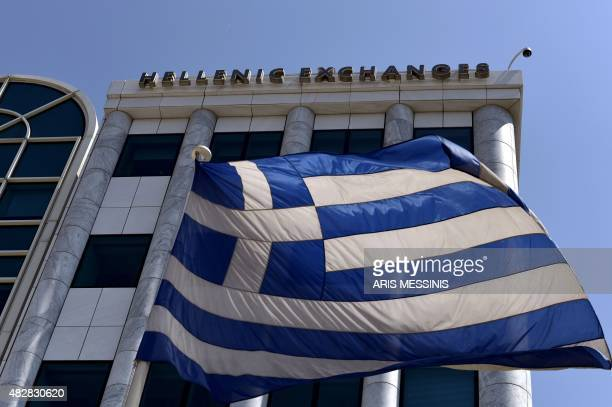 A Greek flag is pictured outside the Athens Stock Exchange in Athens on August 3 2015 Greece's stock exchange reopened August 3 with a drop of more...