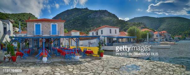 greek flag painted on rocks and fishing boats at agia kyriaki - volos stock pictures, royalty-free photos & images