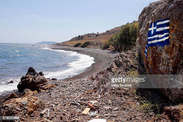 Greek flag painted on rocks can be seen on the beach of Skala Kaminas which was used by refugees to cross Aegean sea from Turkey to Greece last year...