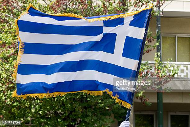 Greek flag waves during the parade Students parade celebrating the 'Ochi Day' during the 75th anniversary of Greece's entering WWII after denying the...