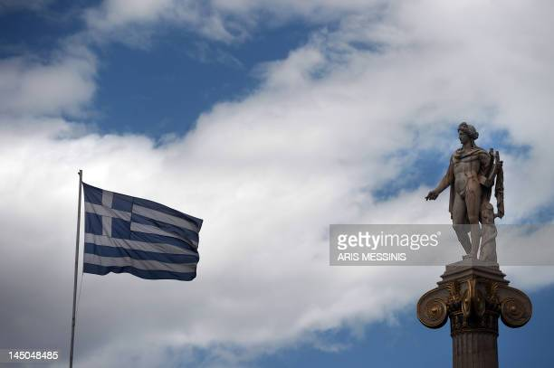 A Greek flag waves next to a statue of the Greek ancient god Apollo in Athens on 23 May 2012 IMF chief Christine Lagarde warned on Wednesday of the...