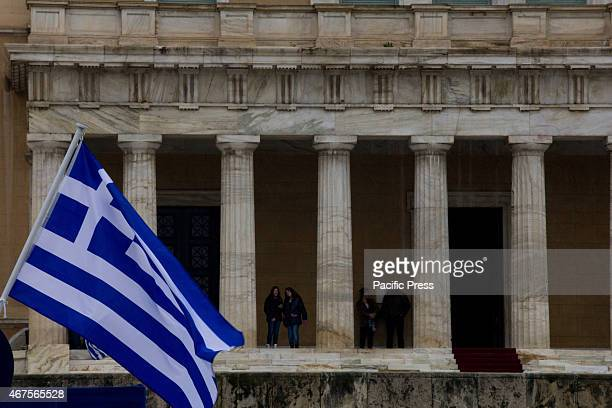 Greek flag waves outside the Parliament The anniversary of Greece's liberation from Turkish occupation in 25th March 1821 celebrated today with a...