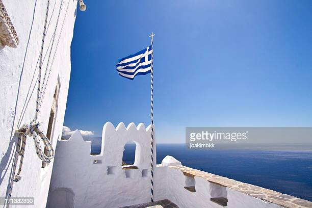greek flag waving in the sky - greek flag stock pictures, royalty-free photos & images