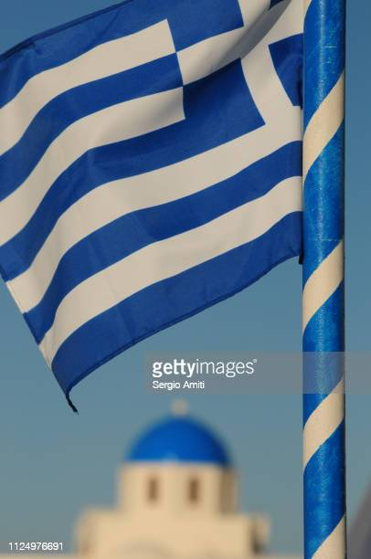 greek flag with blue domed church - flagpole sitting stock photos and pictures