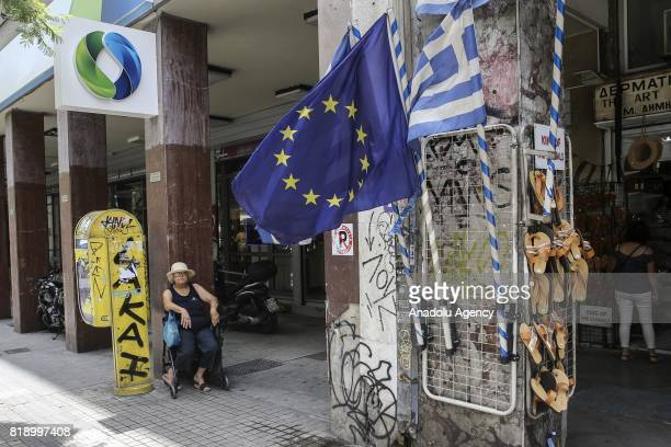 Greek Flags and a flag of European Union are seen in Athens Greece on July 18 2017 Greek government prepares to become indebted to free markets three...