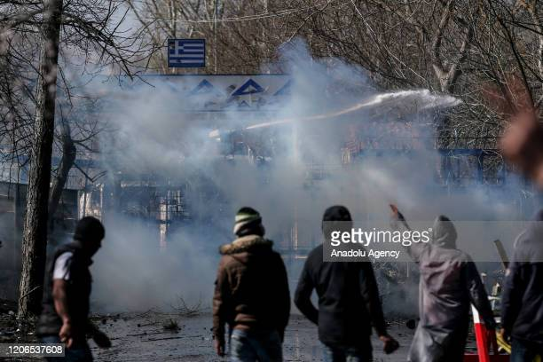 Greek forces intervene in asylum seekers with tear gas and pressurized water as the asylum seekers continue to wait at woodland near buffer zone...