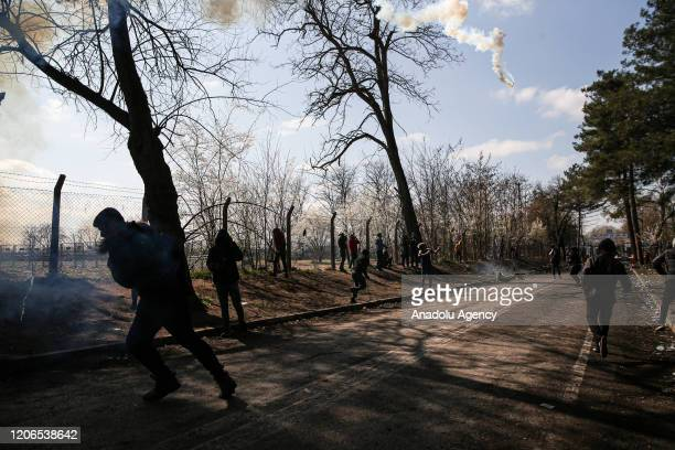 Greek forces intervene in asylum seekers with tear gas as the asylum seekers continue to wait at woodland near buffer zone located between the...