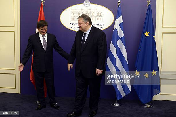 Greek Foreign Minister Evangelos Venizelos greets his Turkish counterpart Ahmet Davutoglu upon his arrival for a meeting in Athens on December 13...