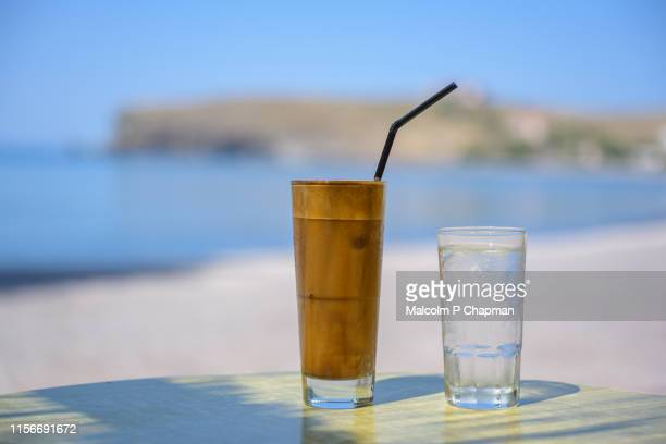 greek frappe iced coffee and water, tavari, lesvos, greece - greece stock pictures, royalty-free photos & images