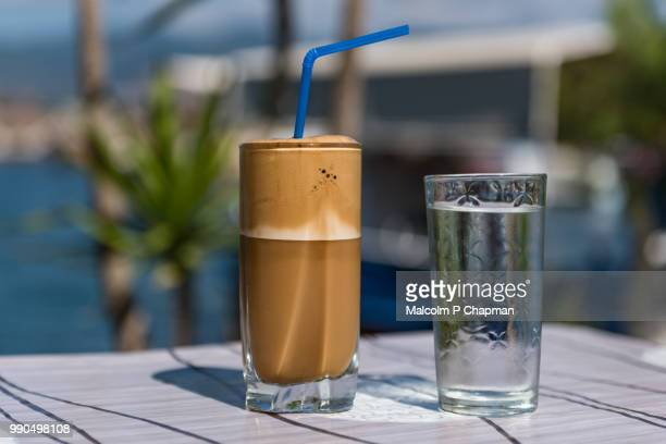 Greek Frappe with milk - iced coffee drink by the sea, Lesbos, Greece