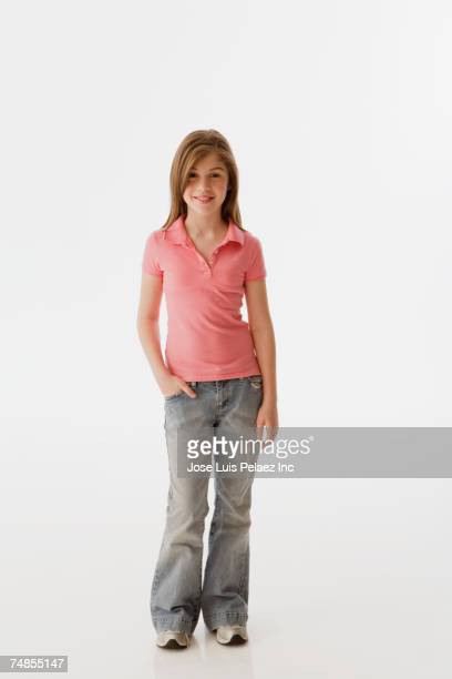 Greek girl standing with hand in pocket