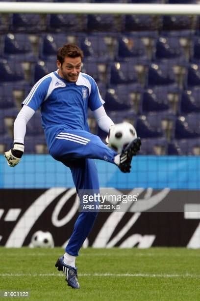 Greek goalkeeper Alexander Tzorvas plays with a ball during a training session at WalsSiezenheim stadium in Salzburg on June 17 2008 Greece will face...