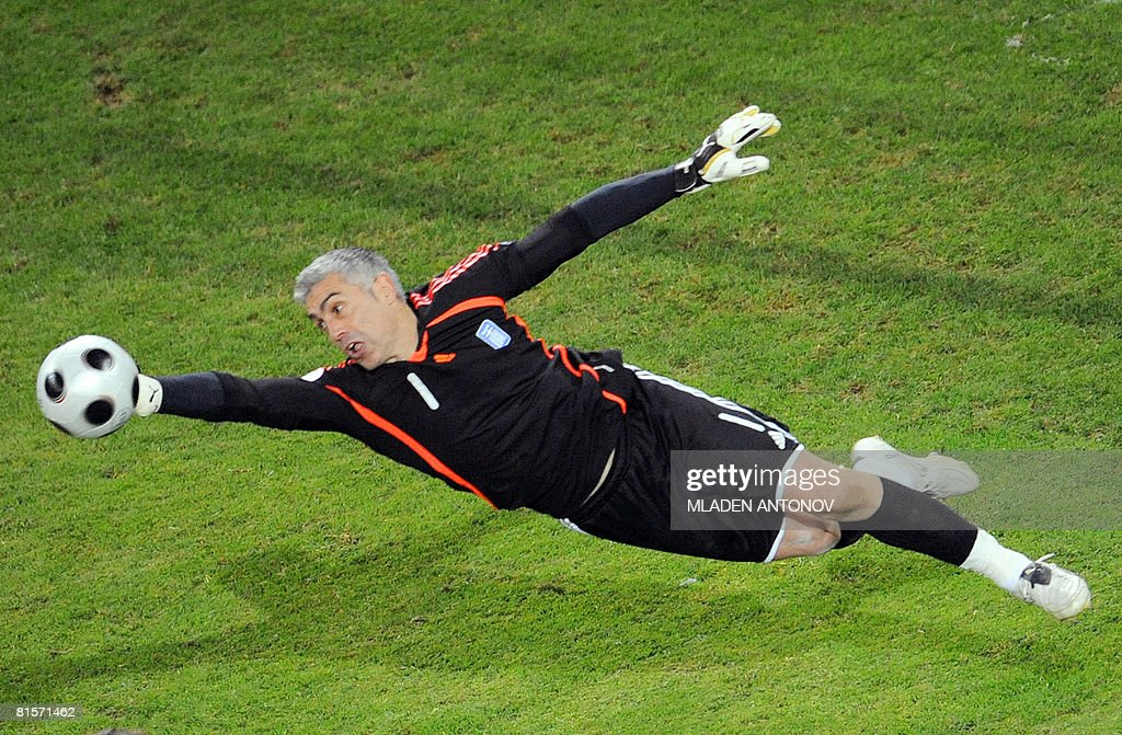 Greek goalkeeper Antonis Nikopolidis dives to deflect the ball during the Euro 2008 Championships group D football match Greece vs. Russia on June 14, 2008 at the Wals-Siezenheim stadium in Salzburg.