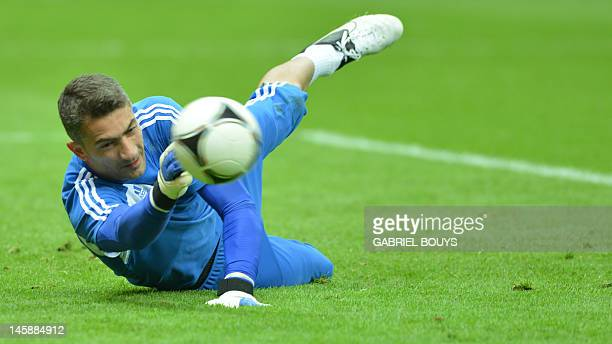 Greek goalkeeper Kostas Chalkias dives as he takes part in a training session of the Greece's national football team on June 7 2012 at the National...