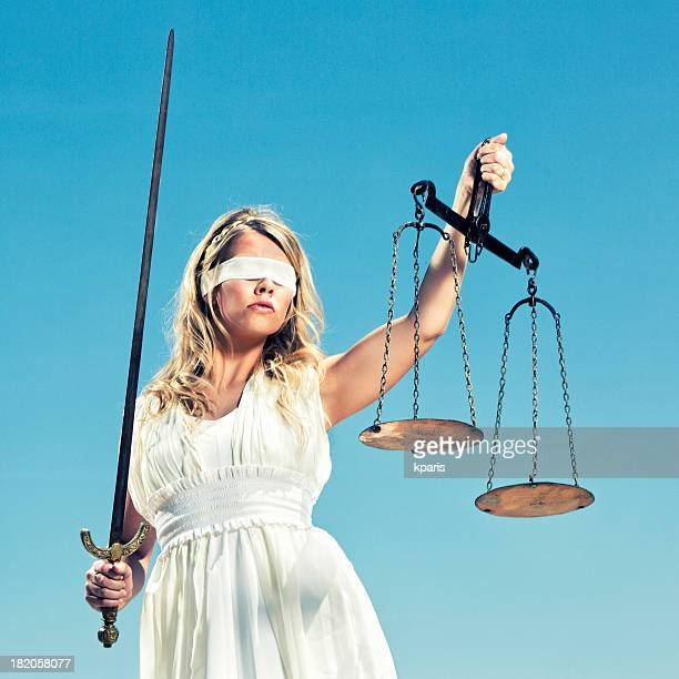 greek goddess themis with a sword and a justice scale - lady justice stock pictures, royalty-free photos & images
