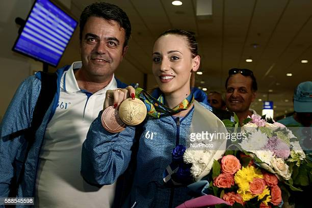 Greek gold medalist at the Rio 2016 Olympics Anna Korakaki with her father and personal coachTasos Korakakis pose to press photographers at the...