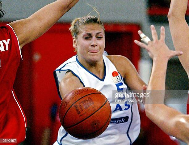 Greek guard Anastasia Kostaki tries to to passe between Hungarian players during Greece vs Hungary which counts for semifinal winner at the 29th...