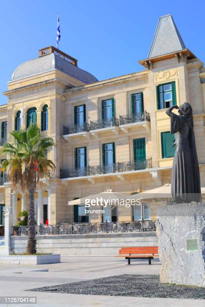 greek heroine bouboulina in front of poseidonion grand hotel, spetses island - spetses stock pictures, royalty-free photos & images