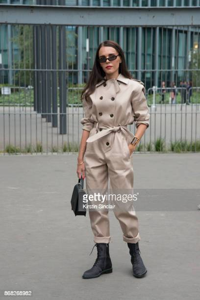 Greek Influencer Evangelie Smyrniotaki from Styleheroine wears a Wanda Nylon jumpsuit The Row boots Balenciaga sunglasses and Byredo bag day 3 of...
