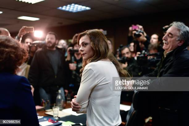 Greek Labour Minister Effie Achtsioglou reacts as Communistaffiliated PAME workers unionists argue with her after storming into the Labour ministry...