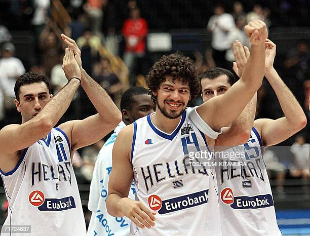 ab052e745 Greek Lazaros Papadopoulos celebrates along with Dimos Dikoudis and Michail  Kakiouzis after their victory over China