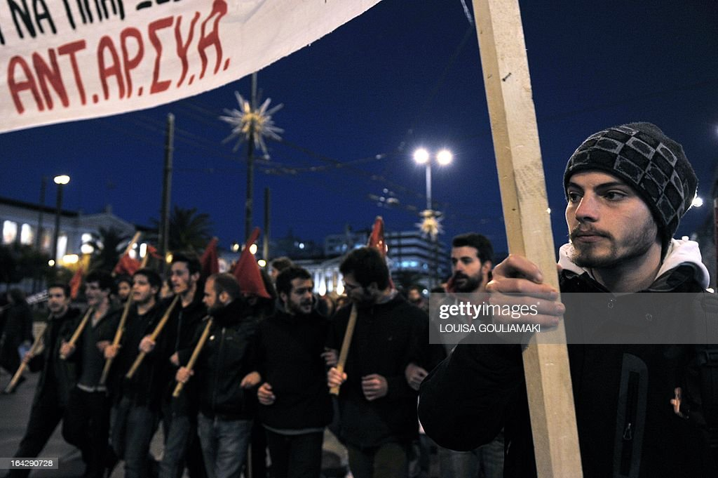 Greek leftists march on March 22, 2013 in the center of Athens in support of Cypriots