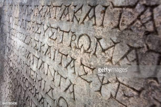 greek lettering in aphrodisias - mitologia greca foto e immagini stock