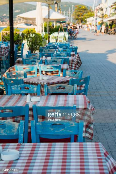 Greek marine with traditional tables and chairs, Lefkada island, Greece