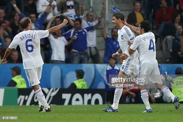 Greek midfielder Angelos Basinas Greek forward Angelos Charisteas and Greek midfielder Nikos Spiropoulos jubilate after Charisteas scored a goal...